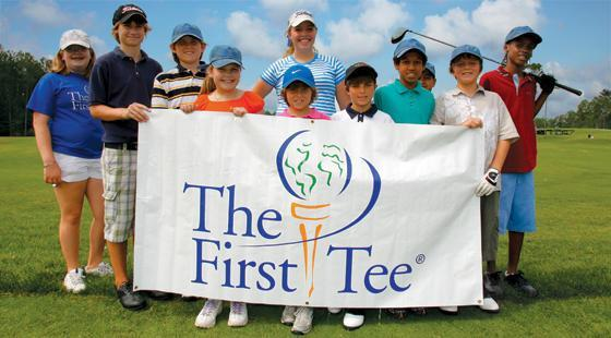 Kids holding First Tee banner